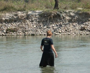 Fully clothed in strategic black for swimming in the Ganga.