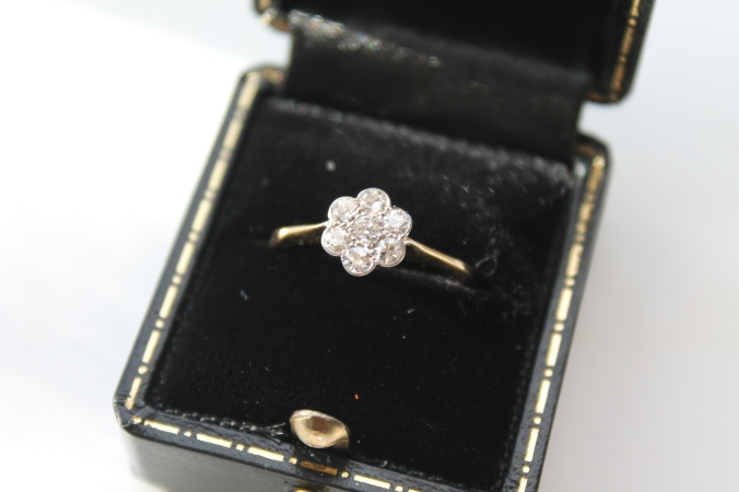 1920s antique ring, with old mine cut diamonds.