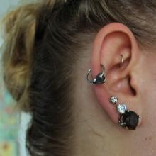 Several Stacked stud earrings.