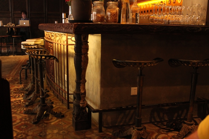 The antique, wooden bar.