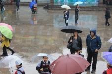 Parents in the rain