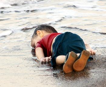 """Alan Kurdi lifeless body"" by Source (WP:NFCC#4)"